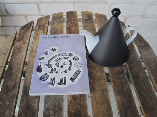 The book with a cheap design tea pot.