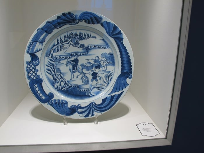 Series of china plates depicting all stages of tea production